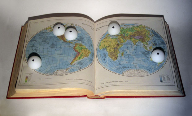 Five Eyes: 5 ping pong balls with felt tip dots embedded into a routed Encyclopedia Britannica volume (physical atlas entry) on Austrlia, Canada, New Zealand, UK, USA.    Kypros Kyprianou, 2014
