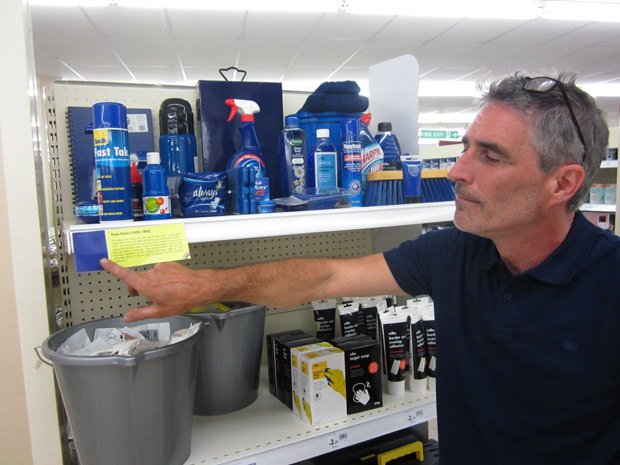 Johnathan pointing at Yves Klein shelf label