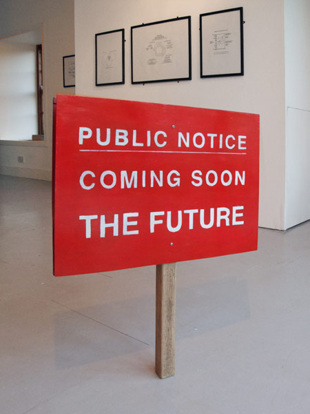 Futures (installation view): Coming Soon The Future - hand painted sign (foreground)  Impossible Cycles carbon paper diagrams (background)  ACA, Old Post Office, Allenheads 2011